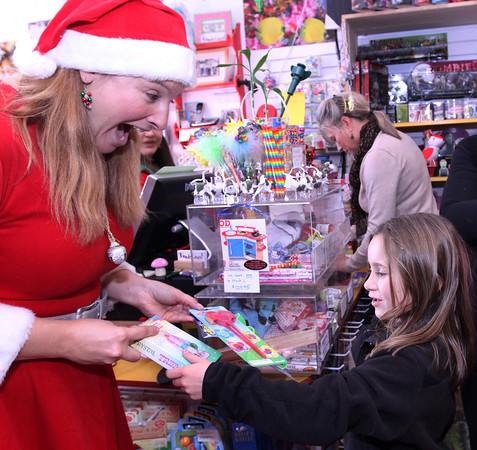 ALLEGRA BOVERMAN/Staff photo. Gloucester Daily Times. Gloucester: ToodleLoos! owner Susan Parent, left, gives a prize to Kaitlyn Jackson, 8, while she shopped at the store with her mother on Friday morning.