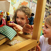 ESSEX—Alli Viggiano, right, and Maggie Goldman, kindergarteners at Essex Elementary School, enjoy playing with the classroom's dollhouse on Thursday afternoon. Jesse Poole/Gloucester Daily Times Nov. 17, 2011