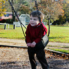 Max Fritsch, 2, of Essex, enjoys time with his mom and swinging at Masconomo Park in Manchester on Wednesday morning. Jesse Poole/Gloucester Daily Times Nov. 2, 2011