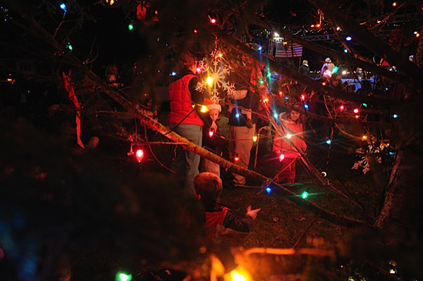 Desi Smith/Gloucester Daily Times. Gloucester: People gather around the Christmas Tree all lit up at Kent Circle late Sunday afternoon, Nov. 27, 2011.