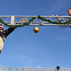 """Courtesy photo/Gloucester Daily Times. Gloucester: Brent """"Ringo"""" Tarr, right, and volunteer Pat Cusick, left, set up lights on the stage at Kent Circle where the Christmas Tree and parade festivities will take place on Sunday."""