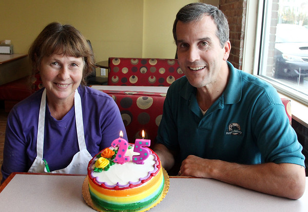 Allegra Boverman/Gloucester Daily Times. Jim Santo is celebrating 25 years of owning his Jim's Bagel and Bake Shoppe. His manager, Gerry Nicastro, left, has been with him for 24 years.