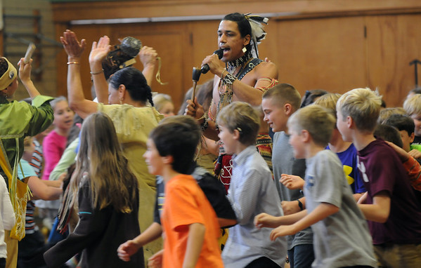 Jim Vaiknoras/Gloucester Times: Fifth graders from the Manchester Memorial School join Annawon Weeden of the Wampanoag Singers and Dancer in a Circle Dance at the school Tuessday.