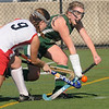 Jim Vaiknoras/Gloucester Times: Manchester Essex player Kelsi Field fights for the ball with Watertowns Emily Loprete during their Division 2 North Sectional Championship Game Monday at North Andover high school. Watertown won the game 2-0.