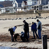 Allegra Boverman/Gloucester Daily Times. Rockport Patrolman Daniel Mahoney, center, with a search team at Long Beach on the Rockport side on Wednesday during a land search of a few  beaches with Mission for the Missing.