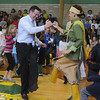 Jim Vaiknoras/Gloucester Times: Manchester Memorial School principal John Willis joins Danielle Hill of the Wampanoag Singers and Dancer in the Mosqueto Dance at the school Tuesday.