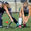 Allegra Boverman/Gloucester Daily Times.  From left: Swampscott's Tessa Beane and Manchester-Essex's Taylor Meek in action during the MIAA North Division II Semi-finals held at North Andover High School on Saturday. Manchester-Essex beat Swampscott 2-0 and will play on Monday in North Andover against Watertown. M-E's Taylor Meek is at far left.