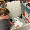 ALLEGRA BOVERMAN/Staff photo. Gloucester Daily Times. Students at Memorial Elementary School in Manchester were participating in a mock Election Day on Friday. Fifth grader Jessica Dunn votes in one of the town's voting booths available for the day.