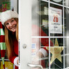 Allegra Boverman/Gloucester Daily Times. Susan Parent of Toodeloos! in downtown Gloucester organized over 25 stores to open at 6 a.m. on Black Friday next week. Participating stores have gold stars on their doors and in their windows, like she has at right on her store's door.