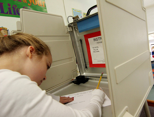 ALLEGRA BOVERMAN/Staff photo. Gloucester Daily Times. Students at Memorial Elementary School in Manchester were participating in a mock Election Day on Friday. Student Sarah Sherman concentrates on her voting choice.