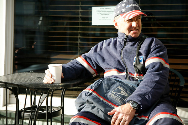 Allegra Boverman/Gloucester Daily Times. Bob Lafond, a Gloucester letter carrier, takes a coffee break at Lone Gull on Main Street in downtown Gloucester on Thursday.