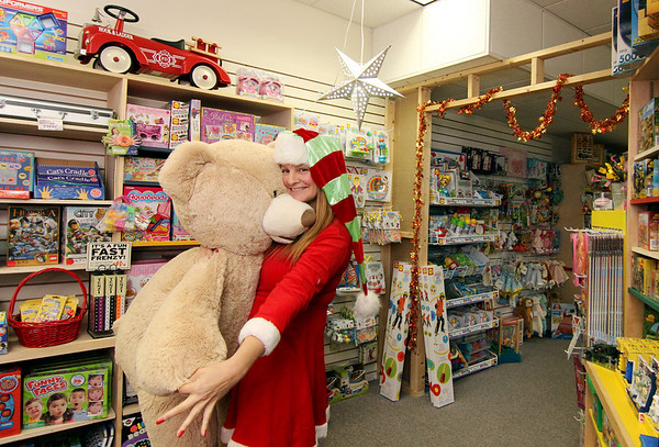 Allegra Boverman/Gloucester Daily Times. Susan Parent of Toodeloos! in downtown Gloucester organized over 25 stores to open at 6 a.m. on Black Friday next week. Participating stores have gold stars on their doors and in their windows.