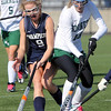 Allegra Boverman/Gloucester Daily Times.  From left: Swampscott's Anna Kane and Manchester-Essex's Paige Zaval in action during the MIAA North Division II Semi-finals held at North Andover High School on Saturday. Manchester-Essex beat Swampscott 2-0 and will play on Monday in North Andover against Watertown. M-E's Taylor Meek is at far left.