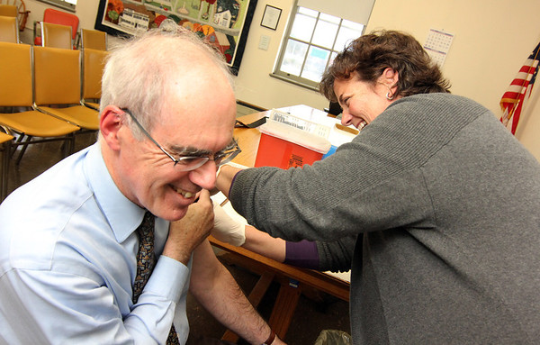 Allegra Boverman/Gloucester Daily Times. Paul Cullinane of Manchester gets a flu shot given by new public health nurse Pamela Ciccone on Thursday. There are other  flu clinics still going on in Cape Ann for those who still need to get them.