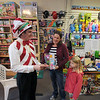 JIm Vaiknoras/Gloucester Daily Times. Nathan Rowe of Toodle Loos! helps out Ella Lorenz, 7, and her mom Alex at the store Friday.