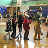 Jim Vaiknoras/Gloucester Times: Students from the Manchester Memorial School join the Wampanoag Singers and Dancers in The Robin Dance at the school Tuesday.