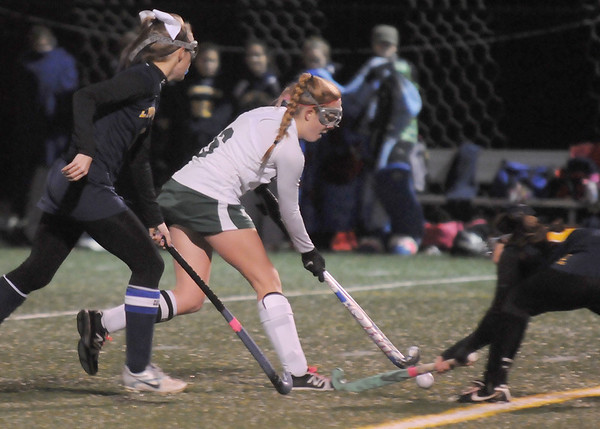 Jim Vaiknoras photo/Gloucester Times: Manchester's Nicole Bradley fight for teh ball with a Lynnfield player during their game at Machester Essex high Saturday night.