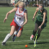Jim Vaiknoras/Gloucester Times: Manchester Essex player Sarah Saergeant fights for the ball with Watertown's Rachel Campbell the Hornet's 2-0 loss to Watertown in the  Division 2 North Sectional Championship Game Monday at North Andover high school.