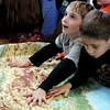 "Allegra Boverman/Gloucestert Daily Times. West Parish second graders Charlie Groleau, left, and Peter Giadano feel the texture of a topographical map during ""The Big Fat Science Show,"" which is going to visit all the elementary schools in the Gloucester school district.  The show features great inventions over the ages from arrowheads to lasers, motors to chain mail."