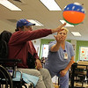 "Allegra Boverman/Gloucester Daily Times. Members of Team Emerson, the PACE at Elder Service Plan of the North Shore team in the Gloucester center, practices their volleyball skills at the center on Emerso nAvenue on Wednesday afternoon. The team of about a dozen seniors is going to compete against other North Shore PACE centers in the PACE Olympics, on Thursday at Danvers Indoor Sports in Danvers. The seniors will compete in volleyball, a disc toss at a target, and ""corn hole,"" a  beanbag toss. From left is Dean Avellis of Hamilton serving the ball with the assistance of Johanna Catania, a rehabilitation aide at the center."