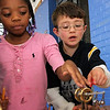 "Allegra Boverman/Gloucestert Daily Times. West Parish Elementary School students La'Neisha Jenkins and Jack Derian examine a sterling engine during ""The Big Fat Science Show"" held at the school on Wednesday. The show features great inventions from throughout the ages from arrowheads to metal armor, maps and motors to kaleidescopes and lasers. The program will be going to all the Gloucester elementary schools."