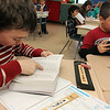 Allegra Boverman/Gloucester Daily Times. Rockport Elementary School third graders Griffin Noble, left, and WIlliam Couchon were eagerly poring over the new dictionaries they received from the Rockport Rotary Club on Thurdsday. Third graders received dictionaries, fourth graders received atlases.