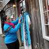 Allegra Boverman/Gloucester Daily Times. Luce Corona, owner of Artesano's of Bearskin Neck, shows how she usually displays some of the clothing and accessories from her store outside.