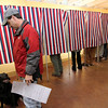 Allegra Boverman/Gloucester Daily Times. Bob Spaner of Lanesville votes at the Lanesville Community Center with his dog, Maggie, 10, who he said was an independent.