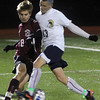 Allegra Boverman/Gloucester Daily Times. Rockport Boys Varsity Soccer team member Luke Catena, left, in action against St. Mary's Josh Bertand at Manning Field in Lynn on Tuesday night. Rockport beat St. Mary's 1-0 in the Div. III North Quarterfinals.