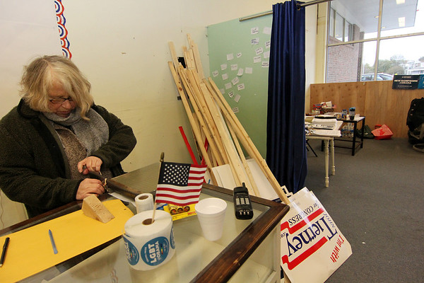 Allegra Boverman/Gloucester Daily Times. Susan Hershey of Rockport, a volunteer for the Glocuester Democratic Committee, helps clean up the headquarters in downtown Gloucester after the elections.