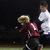 Allegra Boverman/Gloucester Daily Times. Rockport Boys Varsity Soccer team member Sam Roell, left,  in action against St. Mary's Noah Camelo, right,  at Manning Field in Lynn on Tuesday night. Rockport beat St. Mary's 1-0 in the Div. III North Quarterfinals.