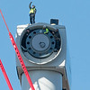Gloucester:  Workers stand inside and on top of the tubine as the crane operator lifts the hub and blades to the trubine for them to bolt it into place Tuesday afternoon in the Blackburn Industrial Park.    Desi Smith/Gloucester Daily Times. November 6, 2012.