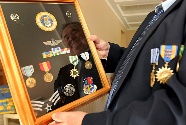 Allegra Boverman/Gloucester Daily Times. Jerry Cook of Manchester, formerly  in the Air Force security service and a retired lieutenant in the Gloucester Police Department, with some of his many medals and awards for his service in Vietnam. Some include a medal for combat action, national defense, and good conduct.