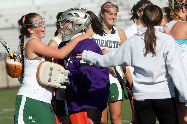 Allegra Boverman/Gloucester Daily Times.  From left: Anna Heffernan, left and goalkeeper Maddi Bistrong, of the Manchester-Essex varsity field hockey team, hug after they won their game against Swampscott in the MIAA North Division II Semi-finals held at North Andover High School on Saturday. Manchester-Essex beat Swampscott 2-0 and will play on Monday in North Andover against Watertown.