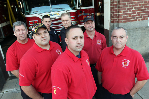 Allegra Boverman/Gloucester Daily Times. Gloucester firefighters wear their red shirts on Fridays to honor veterans. They themselves have several veterans on staff. Front row, from left are: Kyle Benson and Phil Bouchie; second row from left are: Mike Mitchell and Sander Schultz; back row from left are: Randall Silva, Wellington Machado and Mike Sonia.