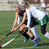 Allegra Boverman/Gloucester Daily Times.  From left: Swampscott's Anna Kane and Manchester-Essex's Paige Zaval in action during the MIAA North Division II Semi-finals held at North Andover High School on Saturday. Manchester-Essex beat Swampscott 2-0 and will play on Monday in North Andover against Watertown. M-E's Taylor Meek is at far right.