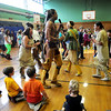 Jim Vaiknoras/Gloucester Times: Fifth graders from the Manchester Memorial School join the Wampanoag Singers and Dancer in a Circle Dance at the school Tuessday.