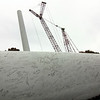 Allegra Boverman/Gloucester Daily Times. The wind turbine construction is coming along at Varian division of Applied Materials in Blackburn Industrial Park. On Friday of last week, one of the blades was signed.