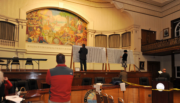 Desi Smith/Gloucester Daily Times. Lucy Sheehan and Mark Nestor, both on the Board of Registrars, tabulate votes as they were coming in after the polls closed on Tuesday night at City Hall in Gloucester. Very few people were on hand to witness the count.