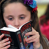 Allegra Boverman/Gloucester Daily Times. Molly Timmons, a fourth grader in the multiage class at Rockport Elementary School looks through a new atlas given to her by the Rockport Rotary Club on Thursday afternoon. Third graders got dictionaries, fourth graders received atlases.