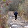 ALLEGRA BOVERMAN/Staff photo. Gloucester Daily Times. Walking briskly in the Manchester Woods on Monday.