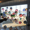 JIm Vaiknoras/Gloucester Daily Times.Larry Williams of Melrose cheaks out the glass window hangings at Out of the Blue on Bearskin Neck in Rockport.