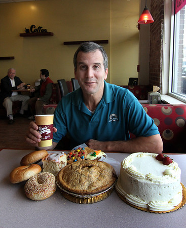 Allegra Boverman/Gloucester Daily Times. Jim Santo is celebrating 25 years of owning his Jim's Bagel and Bake Shoppe.