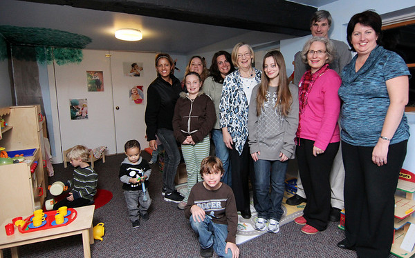 Allegra Boverman/Gloucester Daily Times. Wellspring House's Children's Play Space got refurbished with help from Horizons for Homeless Children very recently. Wellspring's Washington Street shelter's place space also got upgraded. Children were playing there at the Essex Avenue location during the Open House and Annual Meeting on Tuesday evening. Standing from left to right are: Nancis Marte with her son Jariel , 18 months old, volunteers Dawn Bryden and Christine Gordon, both of Gloucester and of the Firs Presbyterian Church of Ipswich, Sarah Fujiwara, of Horizons for Homeless Children, Malorie Verloove of Gloucester, Kay O'Rourke, executive director of Wellspring House, Kelley Bieferman, of Horizons for Homeless Children, and in back, Stephen Croke, also of Horizons for Homeless Children.
