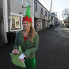 JIm Vaiknoras/Gloucester Daily Times.Melody Orrell dressed as an Elf to hand out coupons to the Mile Marker on Bearskin Neck in Rockport Friday.