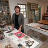 Jim Vaiknoras/Gloucester Daily Times. Patti Hanlon in her studio at Walker Creek Furniture in Essex.