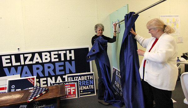 Allegra Boverman/Gloucester Daily Times. Helen Wiseman, left, chair of the Gloucester Democratic Committee and her friend and volunteer Maryanne Metzger of Ohio who is visiting, were dismantling the Gloucester Democratic headquarters in Gloucester on Wednesday after the elections.