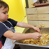 Allegra Boverman/Gloucester Daily Times.  Seamus Linehan, 3, of Gloucester, helps prepare croutons for the salad bar at The Open Door Pantry on Tuesday evening. His grandma, Carole Secrest, was also volunteering there to serve dinner with the St. John's Episcopal Church/Ascension Memorial Church.<br /> <br />  participants in the St. John's Episcopal Church/Ascension Memorial Church dinner held at the food pantry's headquarters on Tuesday evening.