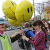 ALLEGRA BOVERMAN/Staff photo. Gloucester Daily Times. Brennah Satterfield, 11, right, of Rockport, gives a bunch of balloons to Five Corners crossing guard Beryl Barnes of Rockport on Friday afternoon on her last day of doing this job. She's been crossing guard in this very spot for 12 to 13 years. Satterfield and her mom and sister, Stasia and Kealy, 7, also gave her owl-shaped cupcakes, and a mini cake. Another family gave her an African violet and the regular kids in that neighborhood gave her lots of handmade, hand-drawn cards.