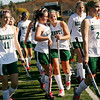 Allegra Boverman/Gloucester Daily Times.  From left:  Manchester-Essex field hockey players Ivy Silag-Stearns, Anna Heffernan, Megan Jones and Allyson Conway and their teammates walk happily off the field after they won their game against Swampscott in the MIAA North Division II Semi-finals held at North Andover High School on Saturday. Manchester-Essex beat Swampscott 2-0 and will play on Monday in North Andover against Watertown.